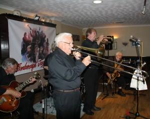 Laurie Chescoe's Reunion Jazz Band at Farnborough JC 3jul2015. (LtoR) Jim Douglas (guitar), Jackie Free (trmb), Alan ('Lord Arsenal') Bradley (trmp) and John Lee (tenor sax). Photo by Mike Witt.
