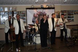 Tony Pitt's All Stars at Farnborough Jazz Club, High St, Farnborough, Kent, UK 29may2015, with Denny Ilett (trmpt), Al Nicols (rds), Dave Hewitt (trmb), Andy Lawrence (db), John Elmer (drms) and Tony (bnj). Photo by Mike Witt.29May2015