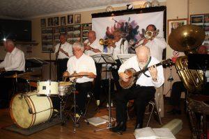 Yerba Beuna Celebration JBYerba Buena Celebration Jazz Band seen here at Farnborough Jazz Club (Kent) on 26th June 2016. (LtoR) Hugh Crozier (piano), Goff Dubber (clarinet), Pete Lay (drums), Mike Barry (2nd trumpet &vocals), Dave Rance (1st trumpet &vocals). Nick Singe (banjo), Graham Wiseman (trombone) and John Arthy (tuba). Photo by Mike Witt.