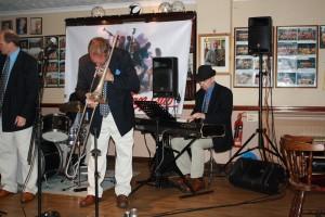 Mardi Gras JazzBand at Farnborough Jazz Club on 21st August 2016. (LtoR) Leigh Henson (trumpet), Rob Pierce (trombone) and Tim Huskisson (piano). Photo by Mike Witt.