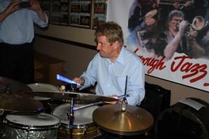 Glowing drummer John Tyson, one of Barry Palser's Super Six at Farnborough Jazz Club, Kent 19June2015. Photo by Mike Witt.