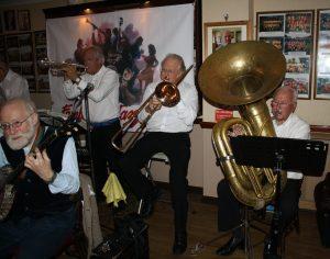 Yerba Buena Celebration Jazz Band at Farnborough Jazz Club (Kent) on 3rd June 2016. (LtoR) Nick Singer (banjo &vocals), Pete Lay (drums), Dave Rance (1st trumpet&vocals), George 'Kid' Tidiman (trombone), and John Arthy (tuba). Photo by Mike Witt.