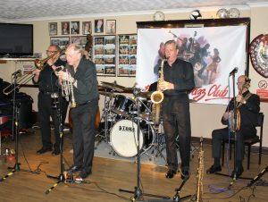 Tony Pitt's All Stars came to Farnborough Jazz Club for Keith's birthday on 12th August 2016. (LtoR) Dave Hewitt (trombone), (hidden) Andy Lawrence (double bass), Alan Gresty (trumpet), (hidden) John Ellmer (drums), Al Nichols (tenor sax) and Tony Pitt (banjo). Photo by Mike Witt.